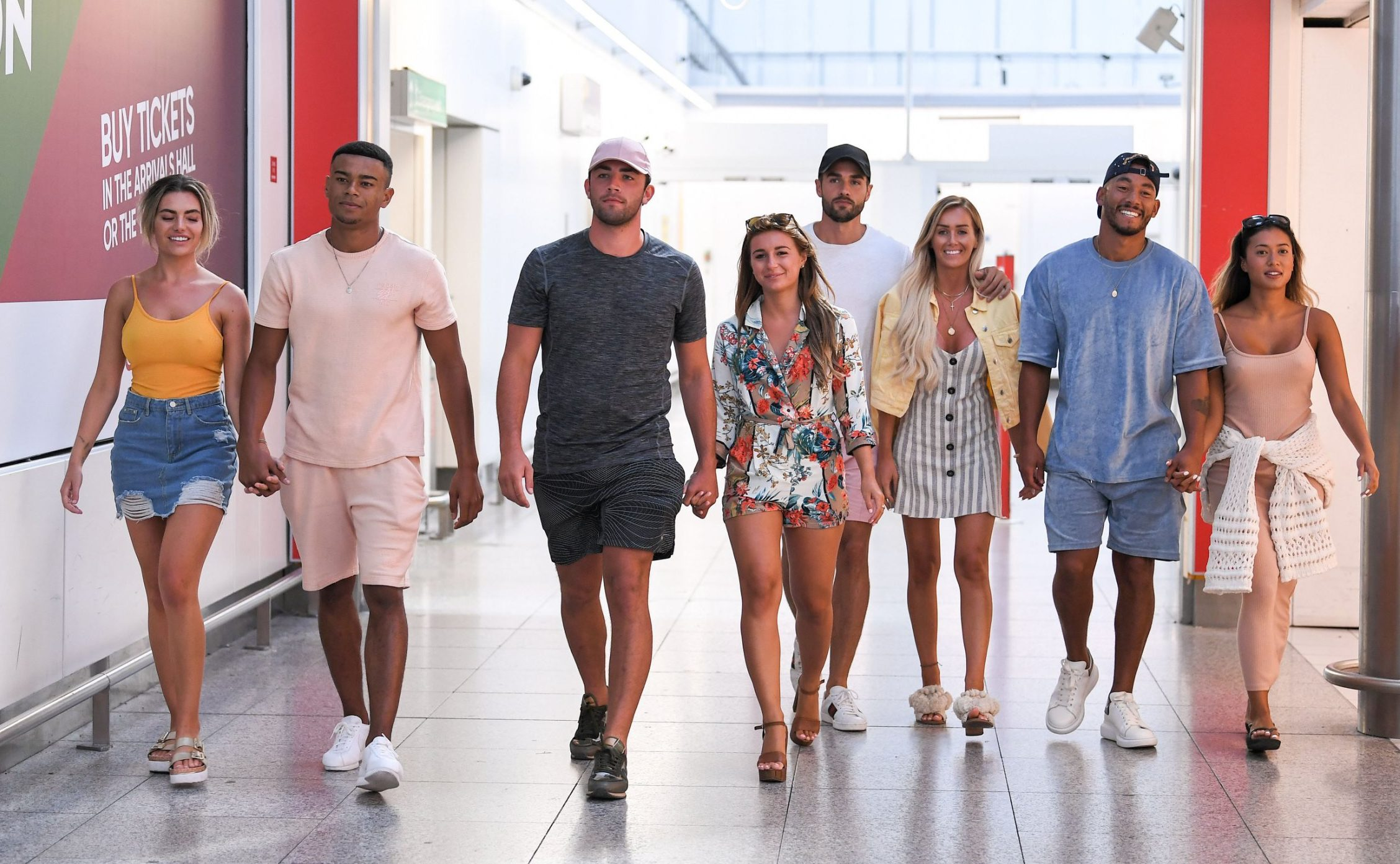 Editorial Use Only. No Merchandising. No Commercial Use Mandatory Credit: Photo by James Gourley/ITV/REX/Shutterstock (9774588bk) Megan Barton Hanson and Wes Nelson, Dani Dyer and Jack Fincham, Laura Anderson and Paul Knops and Kazimir Crossley and Josh Denzel arriving back at Stansted Airport after flying in from Palma de Mallorca 'Love Island' TV Show, Series 4, heading home, Majorca, Spain - 31 Jul 2018