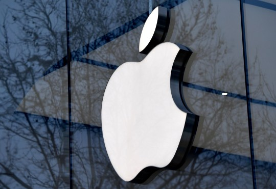(FILES) This file photo taken on February 8, 2018 shows the logo of the US multinational technology company Apple on the facade of an Apple store in Brussels. Wall Street stocks rose early August 1, 2018 on strong Apple earnings and another good set of US hiring data.About 55 minutes into trading, the Dow Jones Industrial Average was at 25,463.48, up 0.2 percent.The broad-based S&P 500 advanced 0.3 percent to 2,824.24, while the tech-rich Nasdaq Composite Index rose 0.6 percent to 7,720.88.Apple shot up nearly five percent after reporting that quarterly profit jumped more than 30 percent to $11.5 billion in the recently ended quarter, besting market expectations despite selling fewer iPhones than analysts projected. / AFP PHOTO / Emmanuel DUNANDEMMANUEL DUNAND/AFP/Getty Images