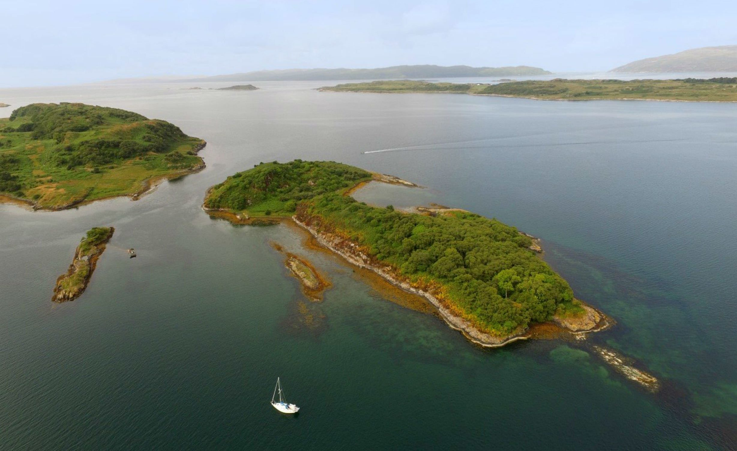 """AN untouched Scottish island whose only nod to the 21st Century is a """"Vodafone signal in some parts"""" is one sale for just ?120,000. And possible buyers of Eilean Nan Gabhar, the Island of the Goats, can forget the convenience of open Sunday afternoon viewings. Prospective purchasers have been warned they must organise their own transport to the island """"at their own risk"""". The island, about 30 miles south of Oban on Scotland's rugged and dramatically beautiful west coast, is the size of about nine football pitches. The island features a secluded bay where boats can be safely anchored, a pebbly beach, abundant flora, ancient woodland and fishing. But the island is otherwise completely without modern services such as water and electricity, and has no buildings. The island, 440m long and 180m wide, has belonged to the same family for over 70 years. Sellers Galbraith describe the sanctuary as a ?superb example of natural island beauty at its best?."""