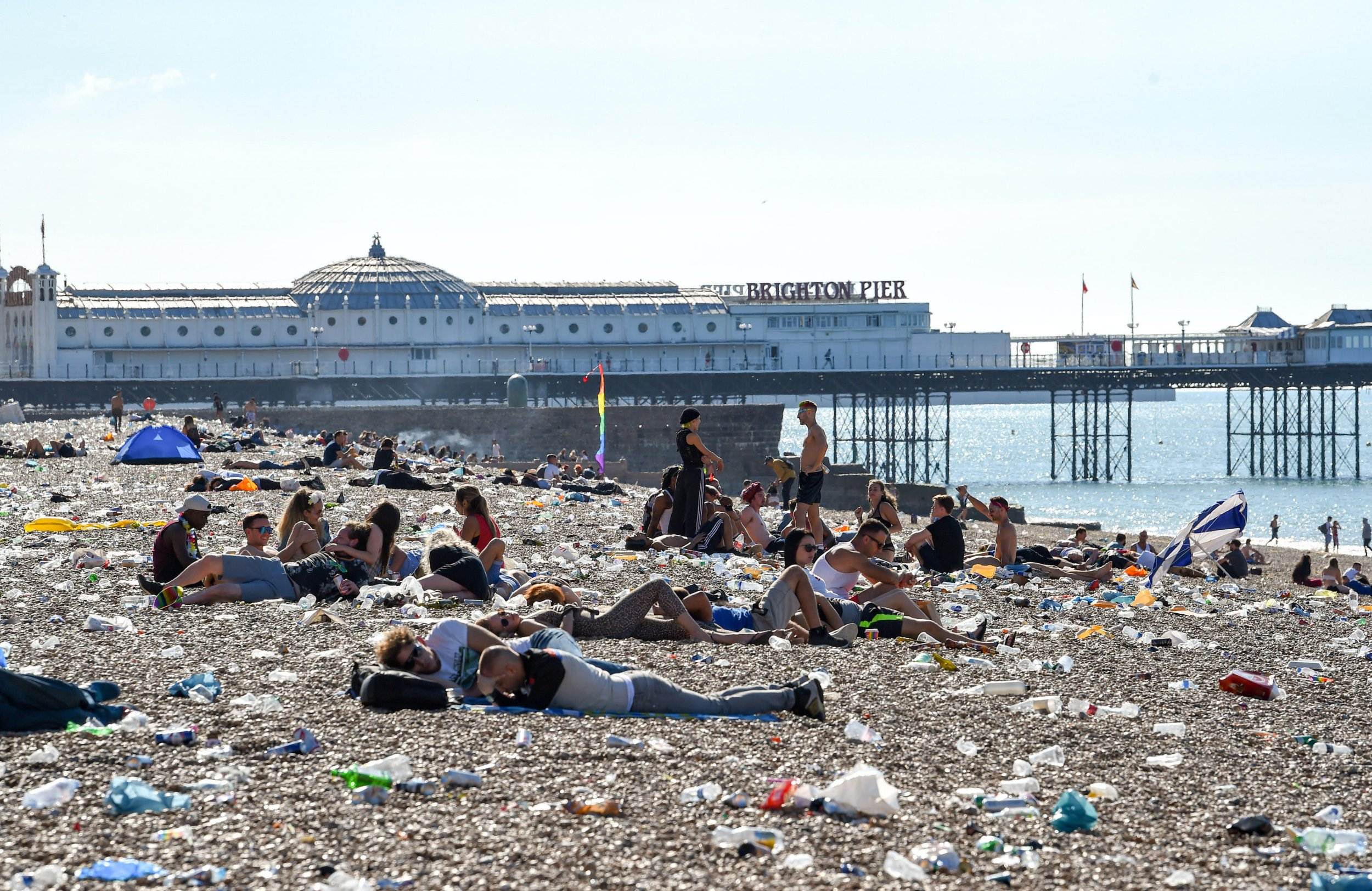 Morning after the night before as people wake up on Brighton beach after Pride