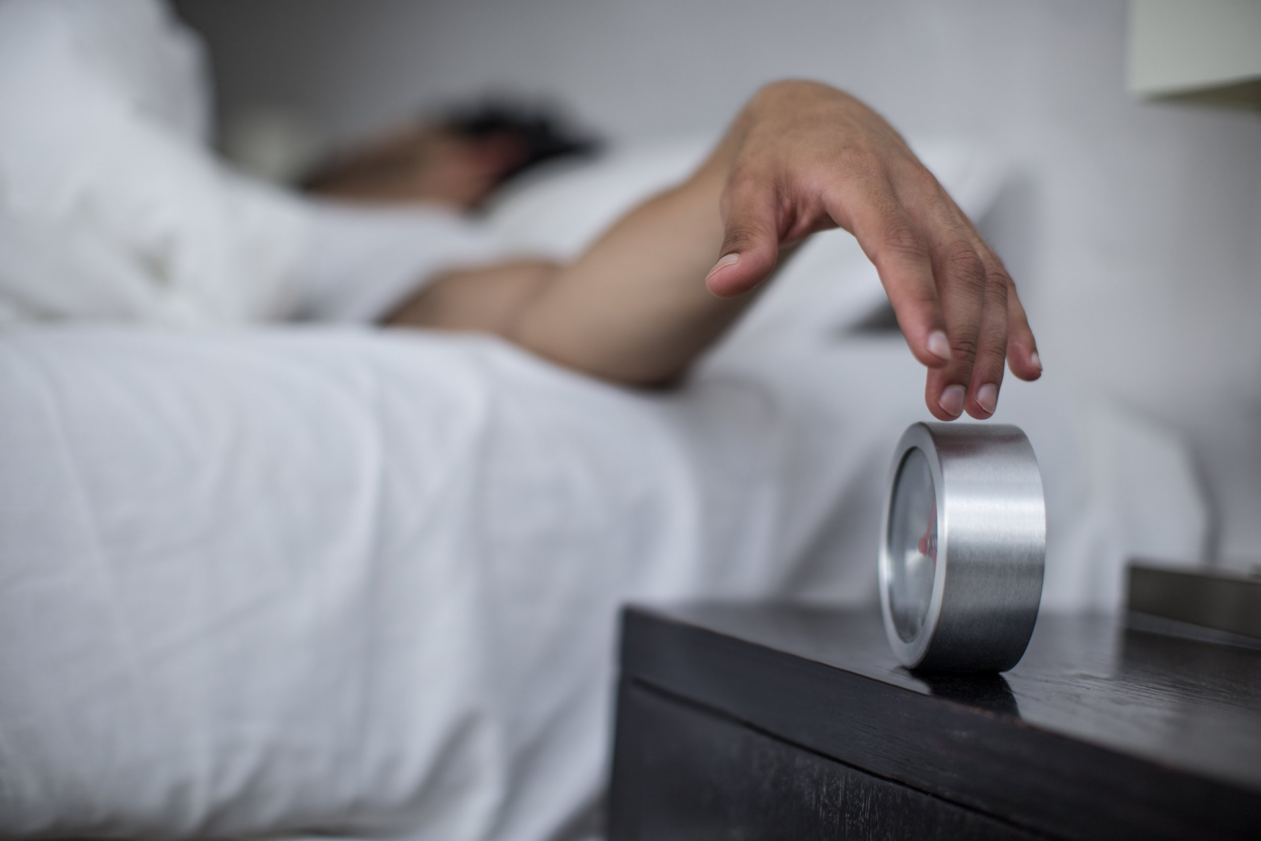 Cape Town, South Africa, young male reaches to turn off alarm clock