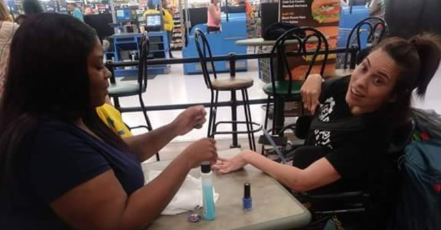 Woman denied a manicure due to cerebral palsy tremors gets her nails done by a kind stranger in Wal-Mart METRO GRAB taken with permission from: https://www.facebook.com/photo.php?fbid=2154325941480226&set=a.1402009636711864.1073741836.100007085227719&type=3&theater Credit: Tasia Smith/Facebook