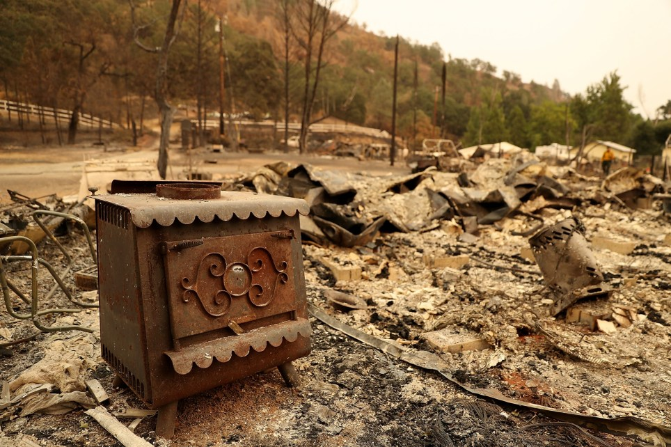 CLEARLAKE OAKS, CA - AUGUST 07: A stove sits in the remains of a home that was destroyed by the Medocino Complex fire on August 7, 2018 near Clearlake Oaks, California. The Mendocino Complex Fire, which is made up of the River Fire and Ranch Fire, has surpassed the Thomas Fire to become the largest wilfire in California state history with over 280,000 acres charred and at least 75 homes destroyed. (Photo by Justin Sullivan/Getty Images)