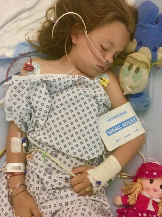 A schoolgirl who embarked on a campaign to help the homeless was left in a coma after suffering a stroke at school. Eight-year-old Isabel Dolby began to cry and clutch the left side of her face while at an after school club on June 28. Caption: Isabel Dolby was left in hospital after suffering a stroke at school