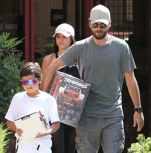 PREMIUM EXCLUSIVE Please contact X17 before any use of these exclusive photos - x17@x17agency.com Wednesday, August 8, 2018 - Mason Disick looks stoked! Scott Disick and Sofia Richie take the excited 8-year-old to Marty's Hobbies toy store in Calabasas to pick up a $1,525 Traxxas remote control Monster truck. Mason wears colorful, futuristic sunglasses and an all-white Nike ensemble, Scott goes casual, and braless Sofia flaunts her assets in a black tank top, and sheer mesh-paneled Kith leggings paired with black Air Jordans. ROL-AZ/X17online.com