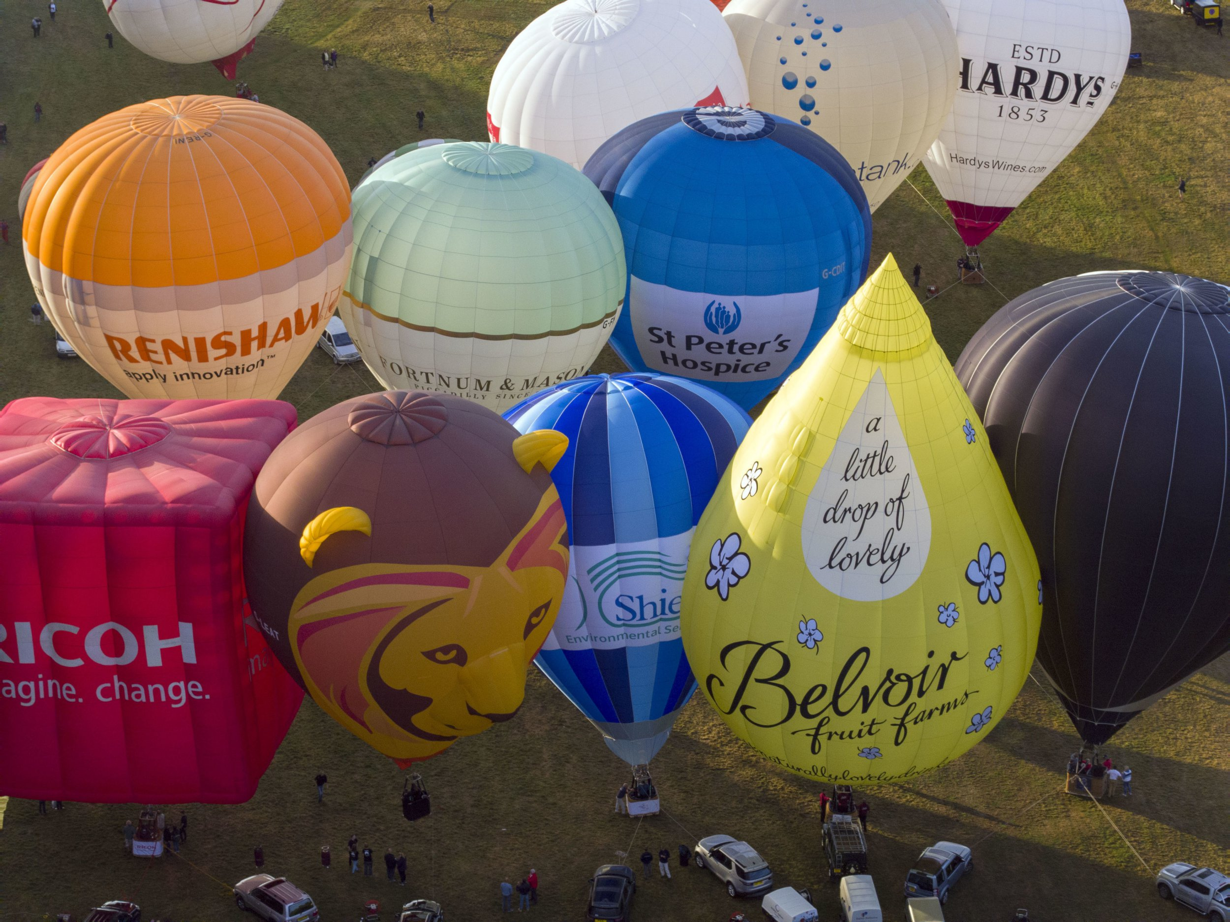 Tethered balloons in the main arena at the Bristol International Balloon Fiesta at the Ashton Court Estate in Bristol. PRESS ASSOCIATION Photo. Picture date: Friday August 10, 2018. Photo credit should read: Steve Parsons/PA Wire