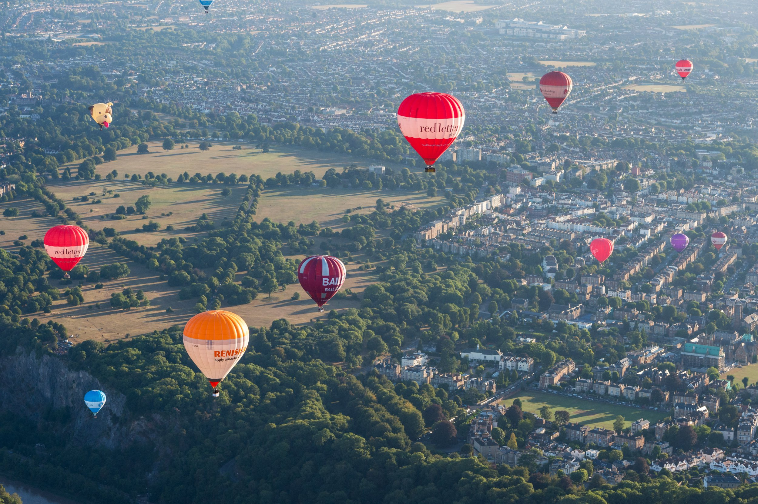? Licensed to London News Pictures. 11/08/2018. Bristol, UK. Bristol International Balloon Fiesta. The morning mass ascent taking place on Saturday morning after the previous mass ascents were cancelled due to weather conditions, at the Bristol International Balloon Fiesta 2018 at Ashton Court estate which runs from Thursday 09 to Sunday 12 August. This year is the event's 40th anniversary and includes some special shape balloons that have not been seen for years, including Rupert the Bear, the giant motorbike, and the Scottish Piper. Photo credit: Simon Chapman/LNP