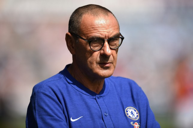 Chelsea's Italian head coach Maurizio Sarri looks on before the English Premier League football match between Huddersfield Town and Chelsea at the John Smith's stadium in Huddersfield, northern England on August 11, 2018. (Photo by Oli SCARFF / AFP) / RESTRICTED TO EDITORIAL USE.No use with unauthorized audio, video, data, fixture lists, club/league logos or 'live' services. Online in-match use limited to 120 images. An additional 40 images may be used in extra time. No video emulation. Social media in-match use limited to 120 images. An additional 40 images may be used in extra time. No use in betting publications, games or single club/league/player publications/ / OLI SCARFF/AFP/Getty Images