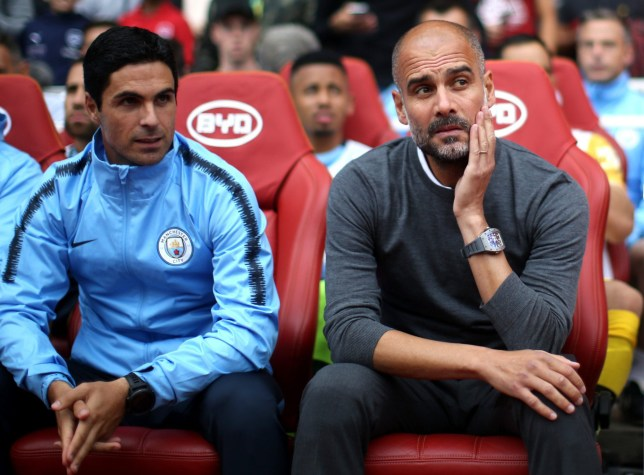 LONDON, ENGLAND - AUGUST 12: Josep Guardiola, Manager of Manchester City and Mikel Arteta, assistant coach of Manchester City look on during the Premier League match between Arsenal FC and Manchester City at Emirates Stadium on August 12, 2018 in London, United Kingdom. (Photo by Tom Flathers/Man City via Getty Images)