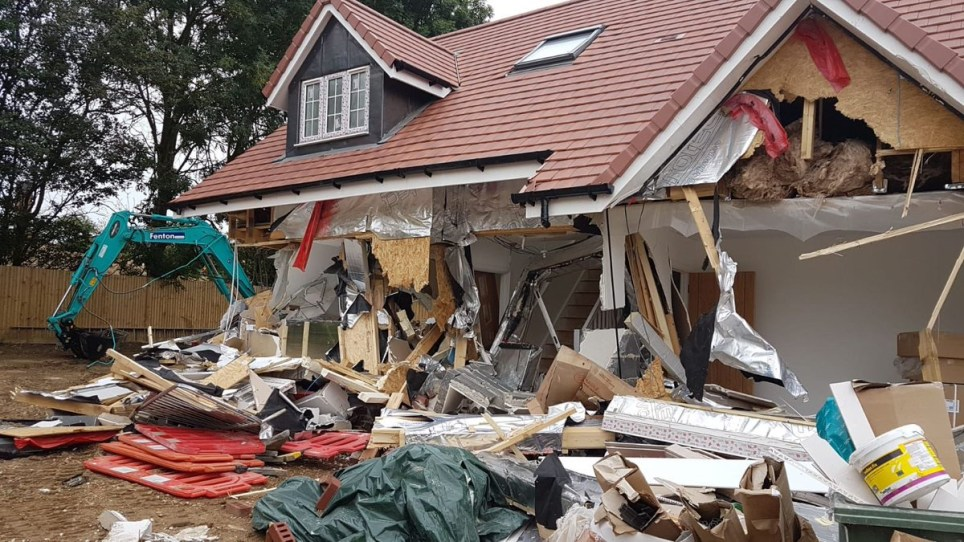 Disgruntled builder smashes down row of new-build cottages METRO GRAB taken from: https://twitter.com/EHertsRrlPolice/status/1028644352304787456 Credit: E Herts Rural Police/Twitter