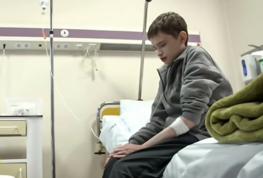 """Pic Shows: Tomasz Nadolski in the hospital; A 25-year-old man says he feels trapped in a child's body because he suffers from a rare disease that makes him look like a 12-year-old boy. Tomasz Nadolski, from the town of Olesnica in south-western Poland's Lower Silesian Voivodeship, suffers from a rare genetic condition known as Fabry disease. """"I am 25 years old and I would like to look like a man of my age. I hate this boy who I see every day in the mirror, because it is not me,"""" he said. Mr Nadolski's problems began when he was seven years old and began vomiting after every meal and started suffering from pains in his stomach, hands and feet. He recalled: """"Friends at school would say: 'Skeletor, you've left Auschwitz!'"""" Doctors were unable to work out what was wrong with him for a long time, suspecting his problems might be mental rather than physical. """"My parents were torn. They saw something going on, but they believed the doctors that I was mentally ill and that I should just eat more,"""" he added. Mr Nadolski says the condition had affected his relationships with his relatives as they still treat him as a child because of his appearance. He said: """"When I'm at home, I'm just sitting in my room and spending my time alone. I feel lonely and I lack the support of my family and this is how it has been for many years. The disease has destroyed our family relationships. And he says that the illness also affects his everyday life as people refuse to accept his real age. """"I often suffer sad situations. When I show the ID card in the office or if the police stop me, they accuse me of having a fake one."""" Fabry disease, which can affect many parts of the body including the kidneys, heart, and skin, results from the build up of a particular type of fat, called globotriaosylceramide, in the body's cells. It is a type of lysosomal storage disorder. Fortunately, the manufacturer of the expensive treatment for the disease has agreed to provide him with the drug for fr"""