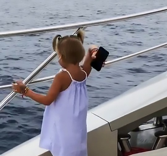 "Pic Shows: Timur's daughter throws his phone in the water; This is the moment a rapper???s spoilt little four-year-old daughter throws his smartphone into the sea in order to get him to pay attention to her. Russian rapper Timati, 34, was speaking on his phone on a yacht while his daughter Alisa was trying to get his attention. She suddenly grabs the phone out of her father's hand, turns around and throws it over the side of the boat before he has chance to react. The tattooed rapper looks at his daughter in shock before jumping up to see his phone has disappeared under the water. Alisa is Timati's daughter with his former girlfriend, glamour model and beauty queen, Alena Shishkova, 24. The incident was caught on camera by somebody else on the yacht who was filming Timati and Alisa at the time. And the video has gone viral online, notching up nearly 5.7 million views, after Timati shared it with his 12.3 million followers on Instagram. Some viewers blamed the little girl's parents for not bringing her up to be more respectful - while others thought the clip had been staged. Netizen ???Petr Zadera??? said: ""This child is out of order. Timati is the one to blame for her bringing her up this way. Let him now enjoy the results"", and ???pepsi_172018??? added: ""What a hysterical monster."" But ???dmitriy_smolkin??? argued: ""Seriously, why the cheap staged video?!"", and ???milashka9128??? agreed: ""That was certainly staged."" Apart from his successful career as a rap singer, Timati is also a businessman with his own clothing line, restaurant and tattoo shop. Alisa's mum meanwhile has modelled on fashion catwalks and for Maxim magazine. She was a runner-up in the Miss Russia 2012 beauty pageant."