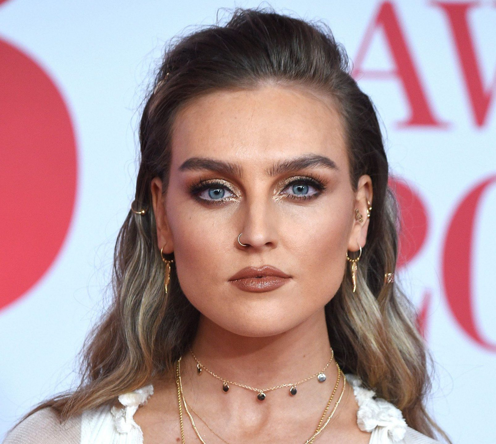 Perrie Edwards has throat operation then consoles herself with chocolate dessert