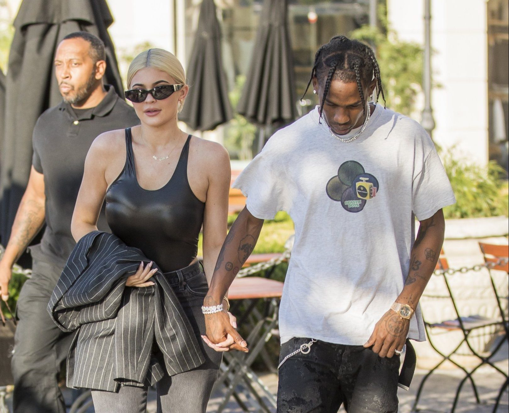 Calabasas, CA - Kylie Jenner and Travis Scott hold hands as they head in to Polacheck's for some shopping a few days after her 21st birthday. Could the pair be looking to finally tie the knot? Pictured: Kylie Jenner, Travis Scott BACKGRID USA 13 AUGUST 2018 BYLINE MUST READ: IXOLA / BACKGRID USA: +1 310 798 9111 / usasales@backgrid.com UK: +44 208 344 2007 / uksales@backgrid.com *UK Clients - Pictures Containing Children Please Pixelate Face Prior To Publication*