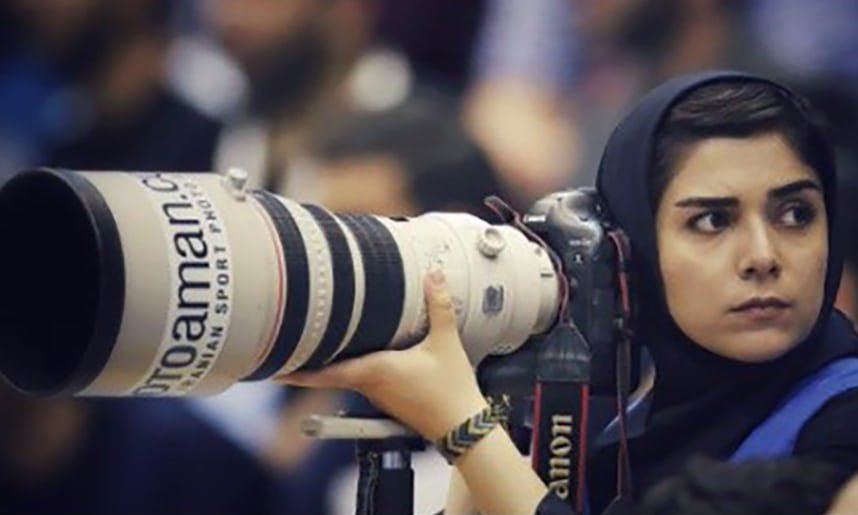 Female photographer banned from football match in Iran comes up with ingenious solution