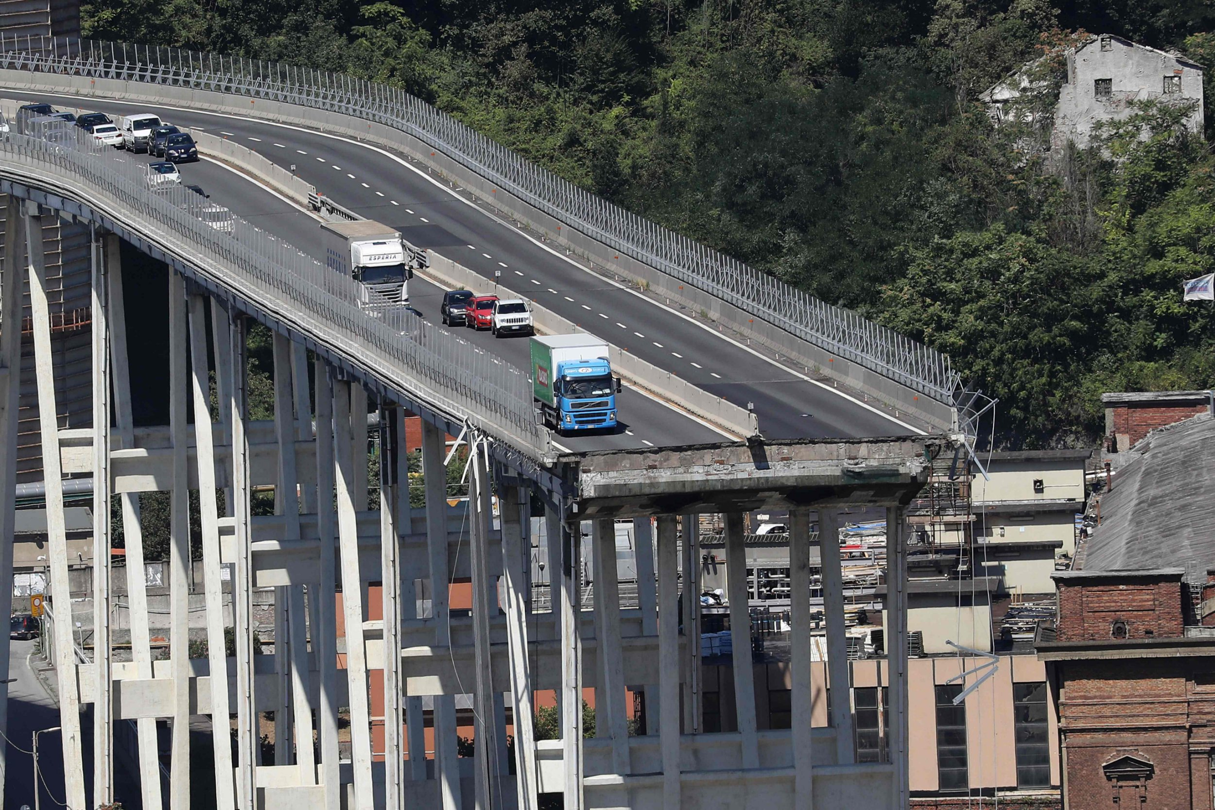 TOPSHOT - This general view taken on August 15, 2018, shows abandoned vehicles on the Morandi motorway bridge the day after a section collapsed in the north-western Italian city of Genoa. - At least 38 people were killed on August 14, when the giant motorway bridge collapsed in Genoa in northwestern Italy. The collapse, which saw a vast stretch of the A10 freeway tumble on to railway lines in the northern port city, was the deadliest bridge failure in Italy for years, and the country's deputy transport minister warned the death toll could climb further. (Photo by Valery HACHE / AFP)VALERY HACHE/AFP/Getty Images