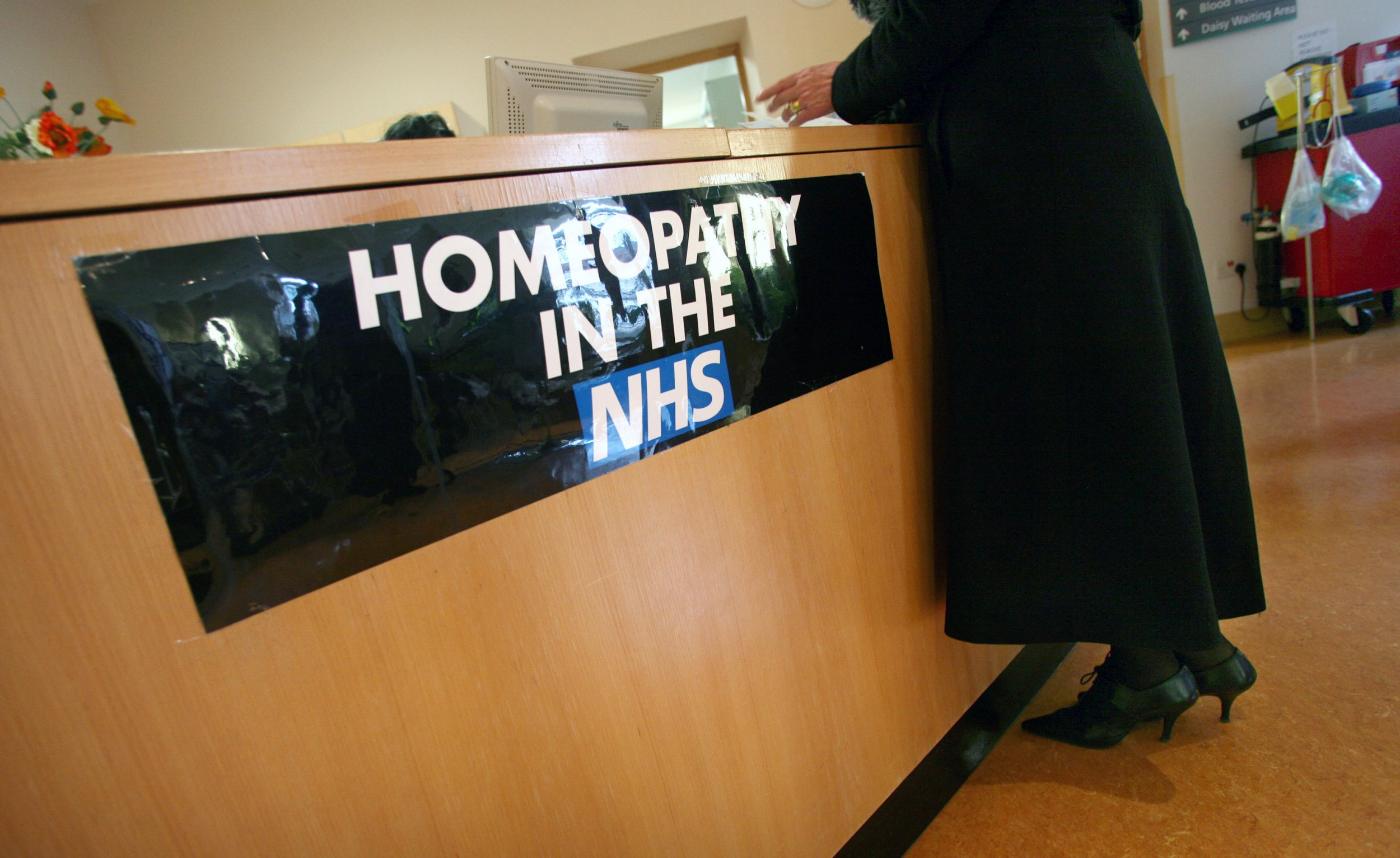 UNITED KINGDOM - MARCH 19: A women stands at the Homeopathy reception desk, at the Royal Homeopathic hospital in London, U.K., on Wednesday, March 19, 2008. Hundreds of cancer victims sought legal remedies in recent years to force the National Health Service's local trusts to pay for drugs that European regulators have approved. (Photo by Graham Barclay/Bloomberg via Getty Images)