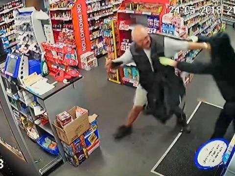 Shopkeeper filmed fighting back against armed robber demanding cash