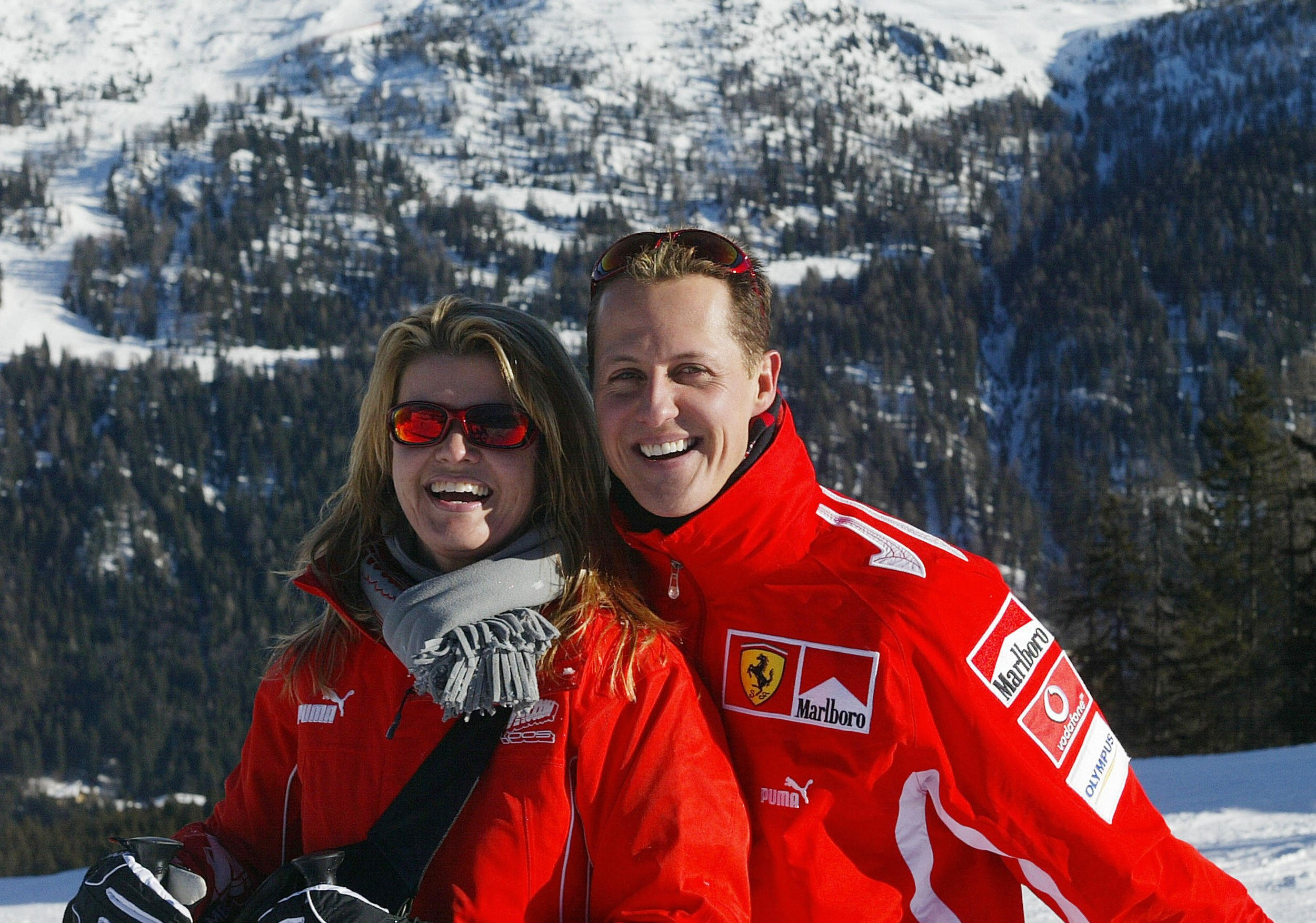 MADONNA DI CAMPIGLIO, ITALY: German Formula 1 driver Michael Schumacher poses with his wife Corinna, in the winter resort of Madonna di Campiglio, in the Dolomites area, Northern Italy, 11 January 2005. Schumacher takes part in the traditionnal Ferrari winter meeting with the press. AFP PHOTO / Press Ferrari (Photo credit should read STR/AFP/Getty Images)