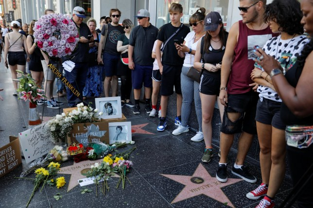 A crowd gathers around Aretha Franklin's star on Hollywood Boulevard, in Los Angeles, California, U.S., August 16, 2018. REUTERS/Mike Blake