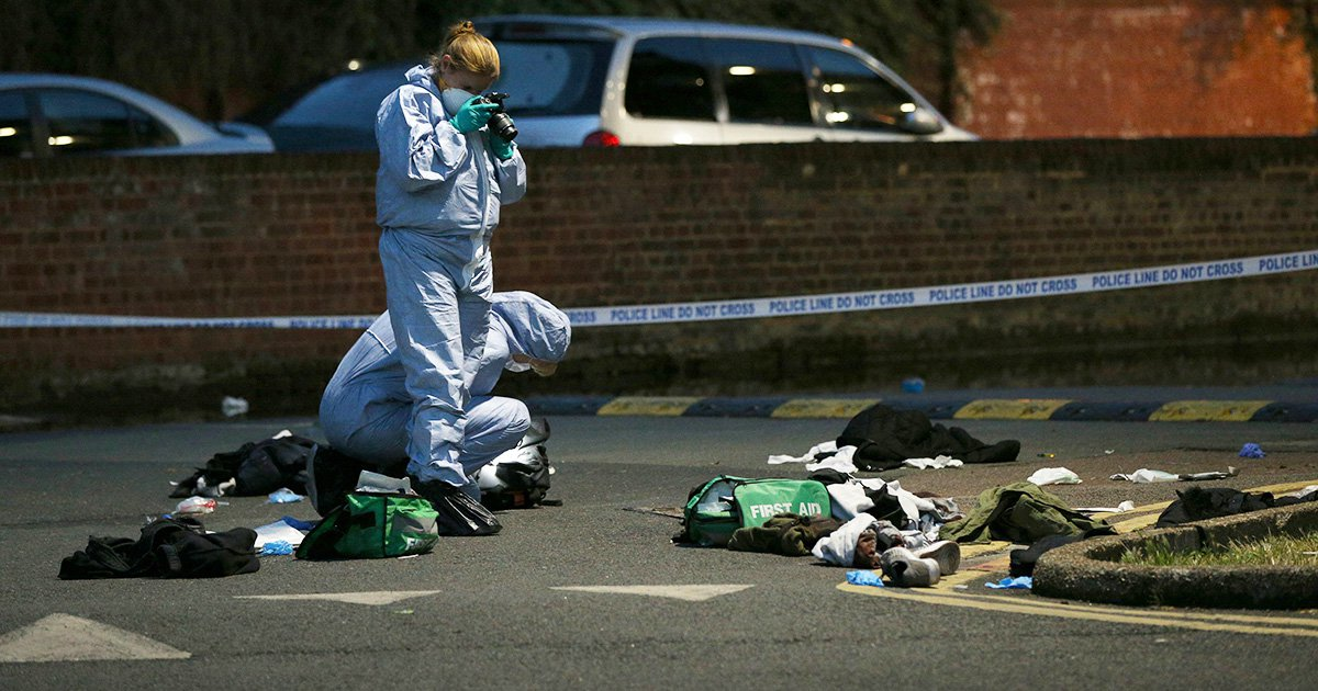Forensics officers inspect the area outside Landor House, Camberwell, London, after four people were taken to hospital with stab wounds. Five males have been arrested. PRESS ASSOCIATION Photo. Picture date: Thursday August 16, 2018. See PA story POLICE Camberwell. Photo credit should read: Jonathan Brady/PA Wire