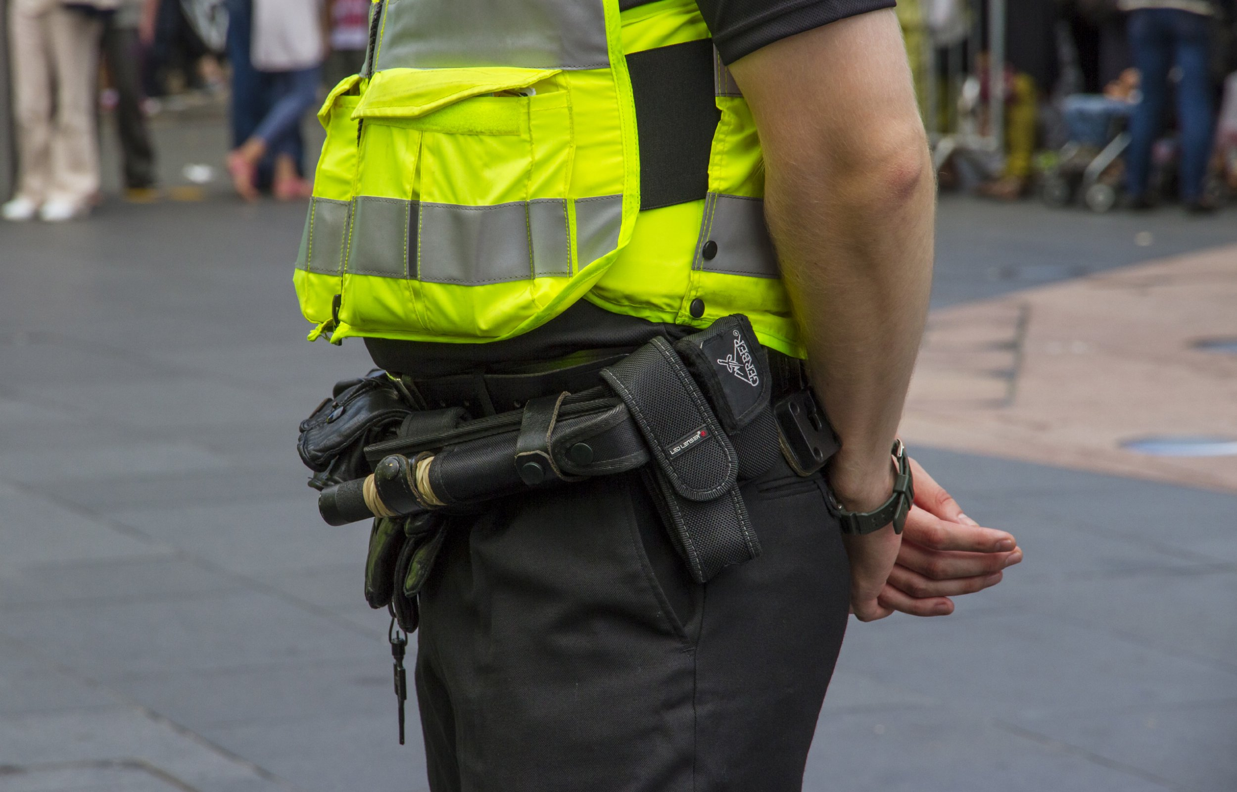 Close up of police officer showing the equipment they carry. (Photo by: Loop Images/UIG via Getty Images)