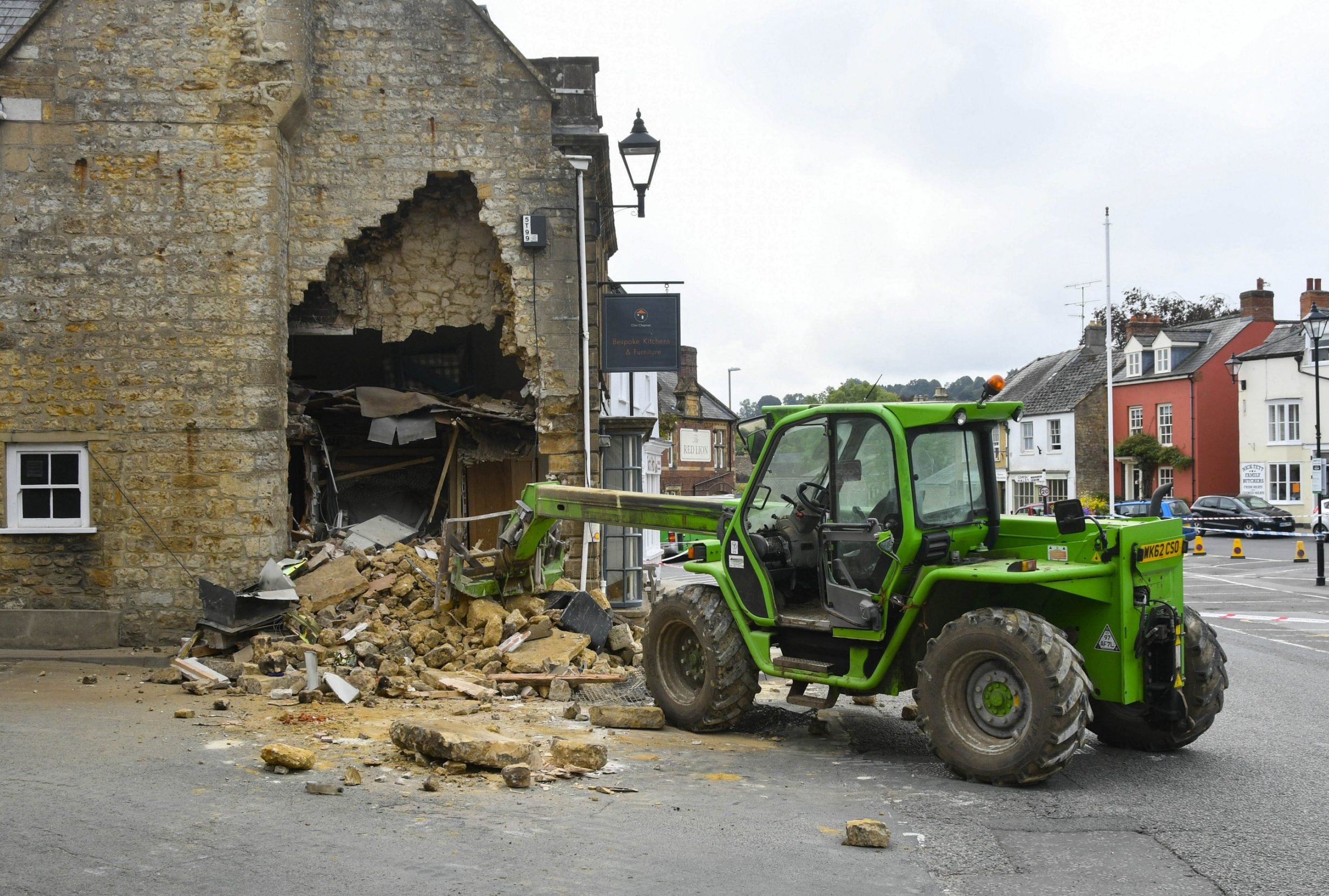 BNPS.co.uk (01202 558833) Pic: GrahamHunt/BNPS Epic Fail... Inept ram raiders have demolished half the wall of a furniture showroom in the sleepy Dorset town of Beaminster last night. The cash machine is still to believed to be in the rubble and the robbers were forced to abandon the tractor used in the raid.