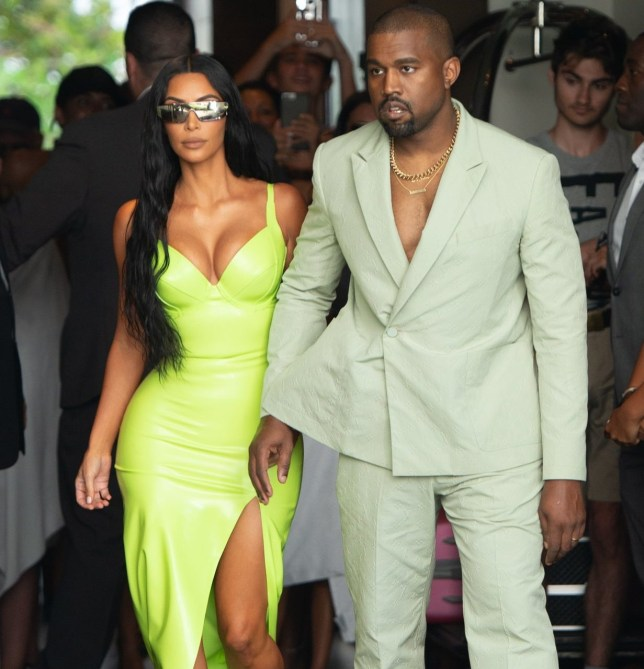 Kim Kardashian and Kanye West arrive at the Versace Mansion in Miami Beach for 2Chainz Wedding Pictured: Kim Kardashian Ref: SPL5016962 180818 NON-EXCLUSIVE Picture by: Garguibo / SplashNews.com Splash News and Pictures Los Angeles: 310-821-2666 New York: 212-619-2666 London: 0207 644 7656 Milan: +39 02 4399 8577 Sydney: +61 02 9240 7700 photodesk@splashnews.com World Rights,