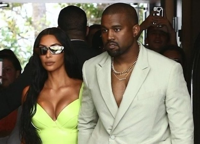 Miami Beach, FL - Kim Kardashian and Kanye West show off her unique wedding guest looks as they are seen outside of the Versace Mansion for a private wedding. Pictured: Kim Kardashian, Kanye West BACKGRID USA 18 AUGUST 2018 USA: +1 310 798 9111 / usasales@backgrid.com UK: +44 208 344 2007 / uksales@backgrid.com *UK Clients - Pictures Containing Children Please Pixelate Face Prior To Publication*