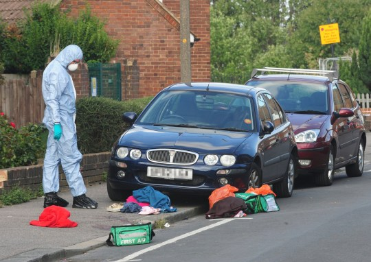 ? Licensed to London News Pictures. 19/08/2018 New Eltham, UK. Police forensics stand over blood covered clothing at the scene of a Hammer attack on two women in New Eltham, south east London. Police are currently searching for 27 year old Joe Xuereb in connection with the attack. Photo credit: Grant Falvey/LNP