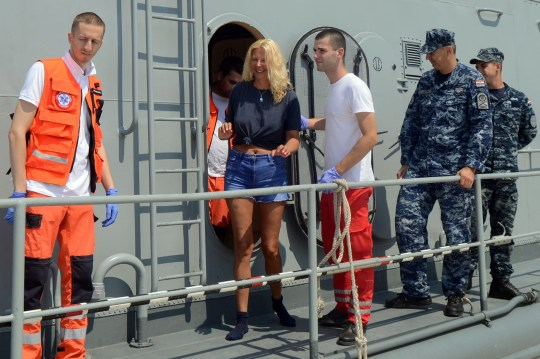 British tourist Kay Longstaff (C) exits Croatias coast guard ship in Pula, on August 20, 2018, which saved her after falling off a cruise ship near Croatian coast. - British tourist Kay Longstaff went overboard from the Norwegian Star cruise ship about 60 miles (95km) off Croatia's coast shortly before midnight on August 18, 2018. She spent 10 hours in the sea before being rescued by Croatias coastal guards, and taken to the hospital. (Photo by STR / AFP) / Croatia OUTSTR/AFP/Getty Images