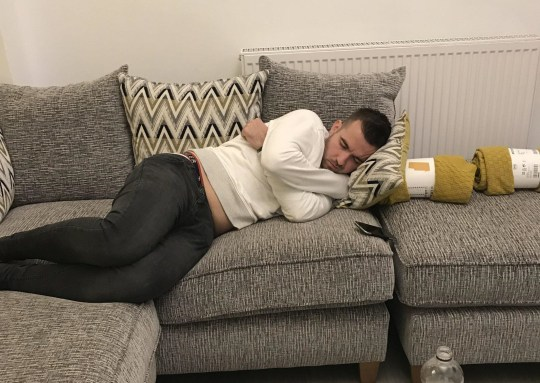 PIC FROM Kennedy News and Media (PICTURED: THOMAS AIRLIE ASLEEP ON THE WRONG HOUSE'S COUCH, WHERE HIS PARENTS LIVED TWO YEARS AGO) A mum of two was given the fright of her life after discovering a drunken stranger asleep on her sofa who had politely left his shoes at the door - as his parents lived there TWO YEARS before. Elaine McDade, 43, had been watching TV in bed with her children on Saturday night in Glasgow, Scotland, when she popped downstairs for a drink. After hearing some noise in her living room, she looked through the door to discover 26-year-old Thomas Airlie, an engineer from South Lanarkshire, in an alcohol-induced slumber on her couch. SEE KENNEDY NEWS COPY - 0161 660 8596
