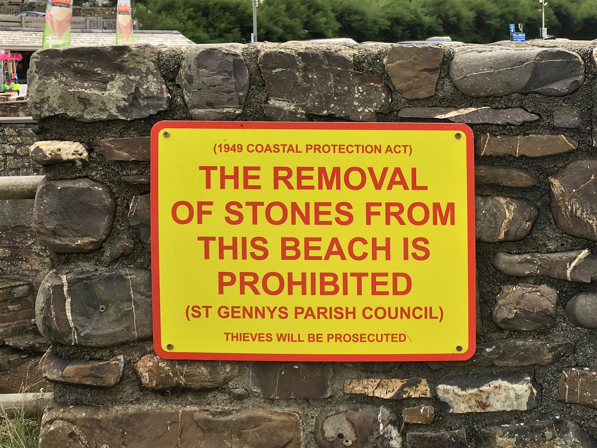 "Authorities traced a man who took pebbles from a beauty spot beach and forced him to travel hundreds of miles to return them or face prosecution. The bizarre incident emerged after complaints that beach visitors were being ""aggressively"" threatened with prosecution for taking stones home at Crackington Haven, Cornwall. Theft had become so common there that several signs were put up to warn it is illegal the parish council said. Visitors could face a fine of up to ??1,000 as removal of stones leaves the area exposed to erosion the clerk for St Gennys Parish Council warned. But critics claimed the signs were heavy handed and spoiled the beach. St Gennys parish clerk Barry Jordan said the signs were installed in late July due to many complaints to the council about stones being removed adding that it was illegal under The Coastal Protection Act 1949. In one case the council traced a holiday maker back to his home hundreds of miles away and he drove a carrier bag of stones all the way back to the beach after being threatened with prosecution Mr Jordan said. ""Those who saw the damage of the floods a few years ago know what water can do, take away the pebbles and the haven would be damaged during every storm,"" Mr Jordan said. ""It's a shame that we must have such a problem with stone theft that the beach is now littered with large red and yellow signs threatening prosecution,"" local artist Jen Dixon said. ""They are so darn ugly on our beautiful beach."" Cornwall Council which owns 57 of the county's beaches said it ""strongly urged visitors not to remove stones or sand"". A spokesperson said: ""It may seem harmless but given the many thousands of visitors to Cornwall's beaches every year every stone removed could have an impact on coastal erosion, natural flood defences and wildlife habitats"". SEE STORY BY APEX NEWS - 01392 823144 ---------------------------------------------------- APEX NEWS AND PICTURES NEWS DESK: 01392 823144 PICTURE DESK: 013 PIC: JEN DIXON/APEX 21/08/2018"