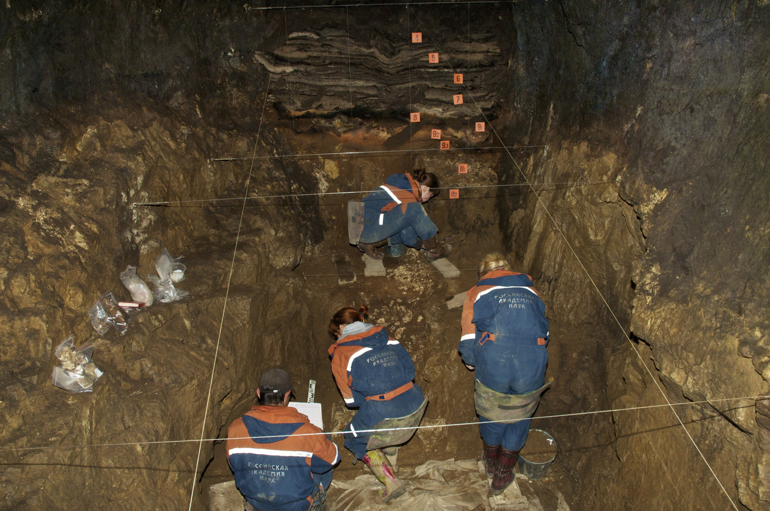 In this 2011 photo provided by Bence Viola of the University of Toronto, researchers excavate a cave for Denisovan fossils in the Altai Krai area of Russia. On Wednesday, Aug. 22, 2018, scientists reported in the journal Nature that they have found the remains of an ancient female whose mother was a Neanderthal and whose father belonged to another extinct group of human relatives known as Denisovans. (Bence Viola/Department of Anthropology - University of Toronto/Max Planck Institute for Evolutionary Anthropology via AP)