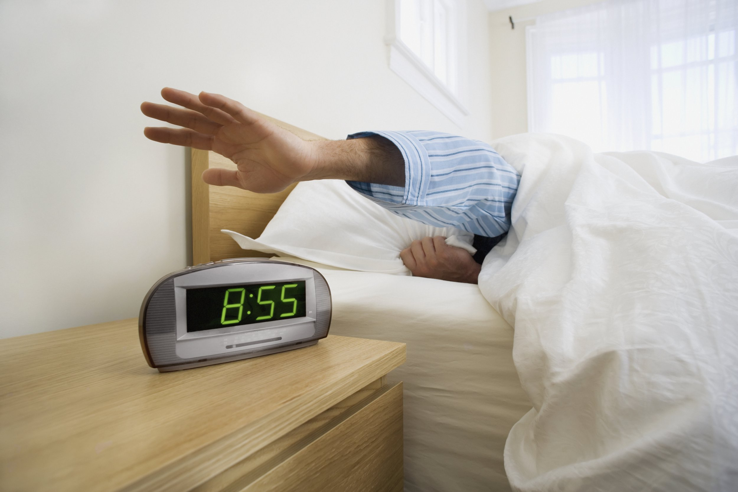Mandatory Credit: Photo by Design Pics Inc/REX/Shutterstock (3357798a) Model Released - Man shutting off alarm clock toronto, Ontario, Canada VARIOUS