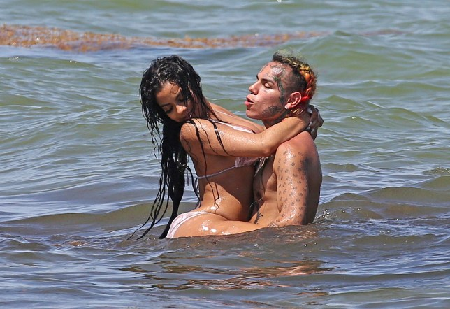 EXCLUSIVE: Controversial rapper Tekashi 69 films a video with two very curvy bikini models on the beach in Miami. 21 Aug 2018 Pictured: Tekashi 69; Tekashi 6ix 9ine. Photo credit: MEGA TheMegaAgency.com +1 888 505 6342
