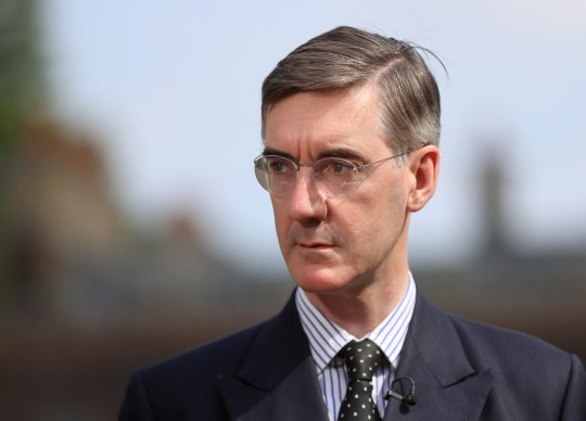 FILE PHOTO: Brexit campaigner Jacob Rees-Mogg talks to the media outside the Houses of Parliament after David Davis resigns from government, in London, Britain, July 9, 2018. REUTERS/Simon Dawson/File Photo