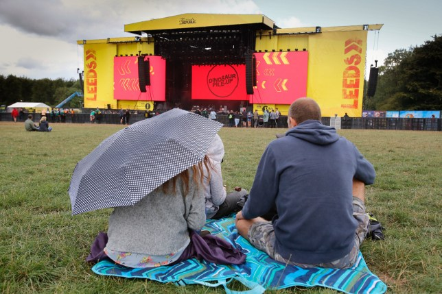 Rain begins to fall at Leeds Festival, Bramham Park, August 24 2018. Leeds Festival returns to its home of Bramham Park in Yorkshire over the August Bank Holiday weekend, Friday 24 to Sunday 26 August 2018. Headlining this year?s festival, which is twinned with its sister event in Reading, are Kings Of Leon, Fall Out Boy and Kendrick Lamar.