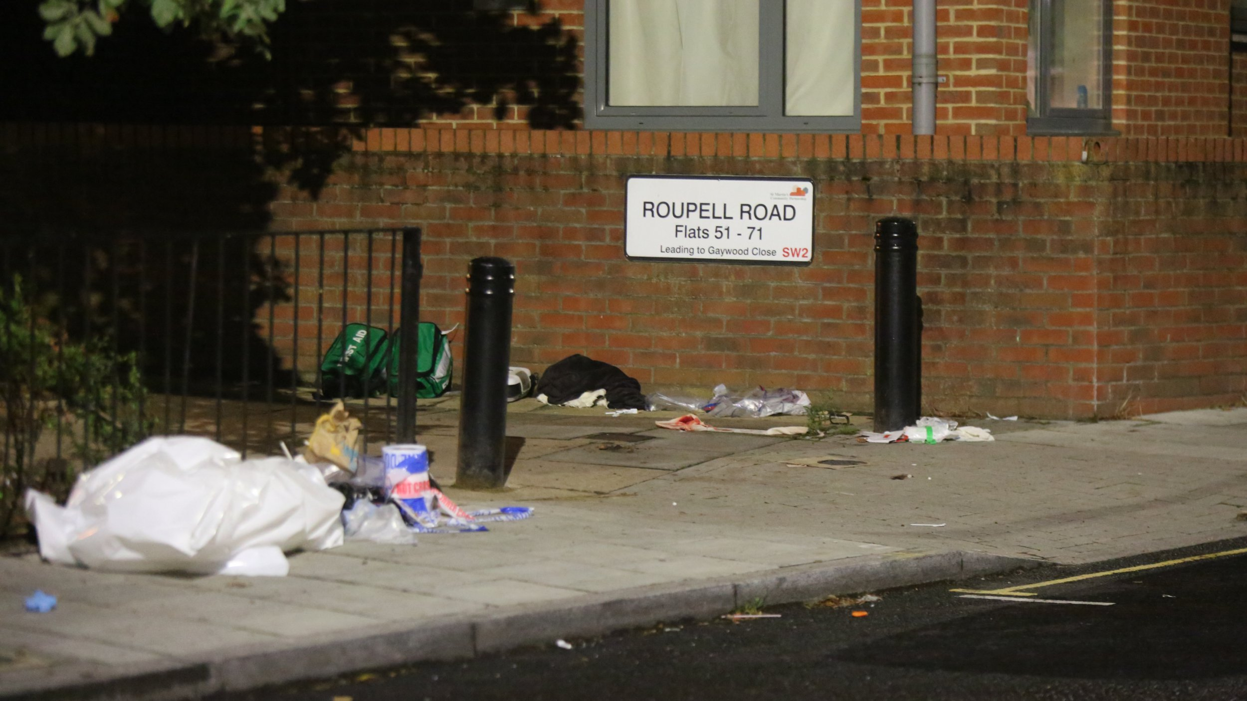 """Rouplell Road Lewisham SW4 Saturday 25th August 2018 Just an other day in Lambeth I am afford the shocking word as officers continue to guard the scene where a 23year old man has been stabbed multiple times. First aid kits and an AED unit covered in blood can be seen were Police officers attempt to save the man life. The broadway light stabbing happened around 5.15pm on Friday. The 23-year-old man is fighting for his life after being stabbed multiple times during a fight in south London. Officers discovered a young victim suffering """"a number of stab wounds,"""" a Metropolitan Police spokesman confirmed. The suspects fled the scene and no arrests have been made as of yet. The injured man was rushed to a south London hospital and his condition has been described as critical. Lambeth police officers who are investigating the incident have recovered a knife at the scene. The force is urging witnesses or anyone with information to come forward. Anyone who witnessed this incident, has footage or can identify those involved is asked to call Lambeth Police quoting CAD5375/24AUG Alternatively you can Tweet @MetCC or call Crimestoppers anonymously on 0800 555 111. ?UKNIP"""