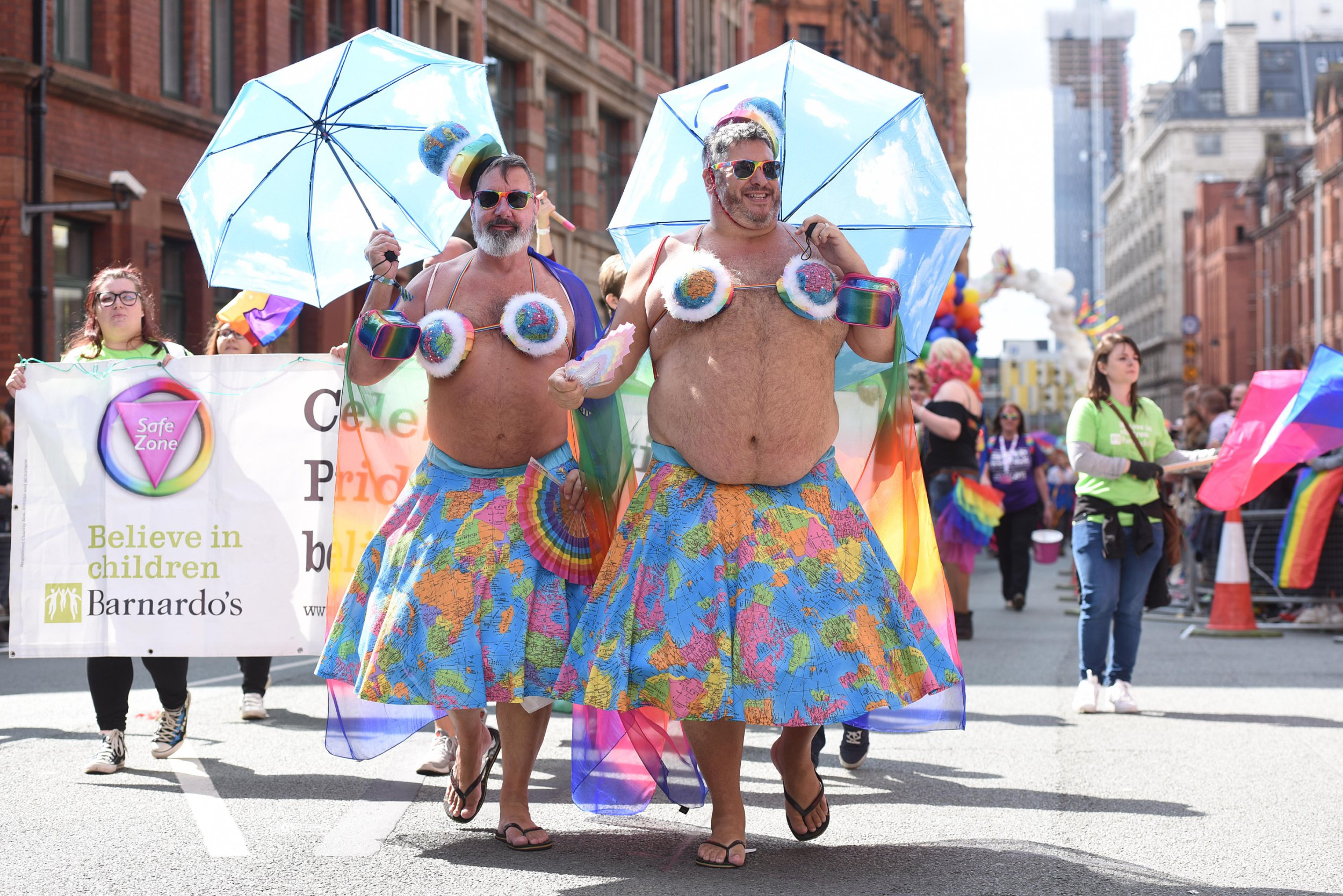 Men wearing Hawaiian-style dress takes part in Manchester?s huge annual Pride through the city centre today (Saturday 25 August 2018). The procession of floats and troupes marks the culmination of the city?s Pride festival, one of the biggest lesbian, gay, bisexual and transgender events in the UK. This year?s parade theme, The Circus of Acceptance, brought stilt walkers, unicyclists, jugglers, trapeze artists, and clowns to the city's streets.