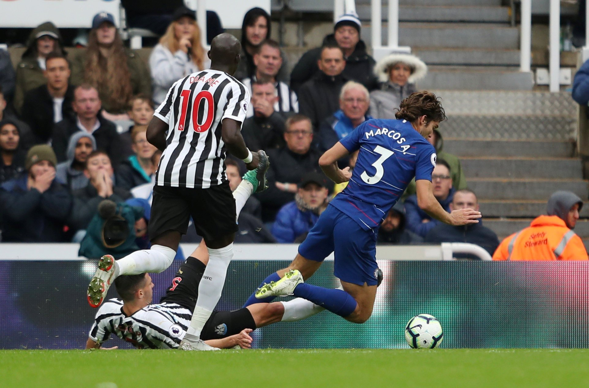 """Soccer Football - Premier League - Newcastle United v Chelsea - St James' Park, Newcastle, Britain - August 26, 2018 Referee Paul Tierney awards Chelsea a penalty after Chelsea's Marcos Alonso goes down under the challenge of Newcastle United's Fabian Schar Action Images via Reuters/Lee Smith EDITORIAL USE ONLY. No use with unauthorized audio, video, data, fixture lists, club/league logos or """"live"""" services. Online in-match use limited to 75 images, no video emulation. No use in betting, games or single club/league/player publications. Please contact your account representative for further details."""