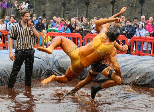 Two brave contestants take part in the World Gravy Wrestling Championships at the Rose ?n Bowl, Stacksteads, August 27 2018. Contestants must wrestle in the gravy for 2 minutes, points are scored for fancy dress, comedy effect, entertainment and wrestling ability. The event is held to raise funds for the East Lancashire Hospice and competitors nominated charities.