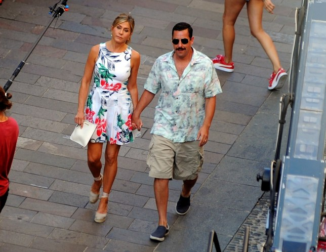 Jennifer Aniston and Adam Sandler are seen on the set of Murder Mystery on August 27, 2018 in Milan, Italy. Pictured: Ref: SPL5018708 270818 NON-EXCLUSIVE Picture by: SplashNews.com Splash News and Pictures Los Angeles: 310-821-2666 New York: 212-619-2666 London: 0207 644 7656 Milan: +39 02 4399 8577 Sydney: +61 02 9240 7700 photodesk@splashnews.com World Rights, No France Rights, No Italy Rights, No Switzerland Rights