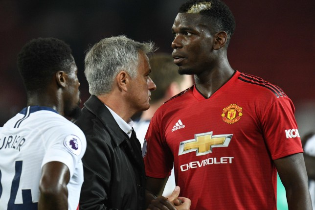Manchester United's Portuguese manager Jose Mourinho (C) greets Manchester United's French midfielder Paul Pogba (R) after the final whistle in the English Premier League football match between Manchester United and Tottenham Hotspur at Old Trafford in Manchester, north west England, on August 27, 2018. (Photo by Oli SCARFF / AFP) / RESTRICTED TO EDITORIAL USE. No use with unauthorized audio, video, data, fixture lists, club/league logos or 'live' services. Online in-match use limited to 120 images. An additional 40 images may be used in extra time. No video emulation. Social media in-match use limited to 120 images. An additional 40 images may be used in extra time. No use in betting publications, games or single club/league/player publications. / OLI SCARFF/AFP/Getty Images