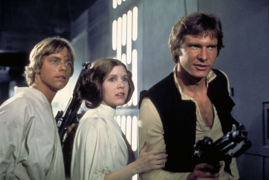 "Film, ""Star Wars: Episode IV, A New Hope"" (1977) Actors, from left, Mark Hamill as Luke Skywalker, Carrie Fisher as Princess Leia and Harrison Ford as Han Solo, appear in a scene from Lucasfilm's ""Star Wars: Episode IV, A New Hope,"" in this undated promotional photo. Lucasfilm Ltd. and 20th Century Fox announced Tuesday, Feb. 10, 2004, that the original three ""Star Wars"" films will be released on DVD on Sept. 21, 2004, in North America. (AP Photo/Lucasfilm, Ltd. & TM)...A...ENT...USA"