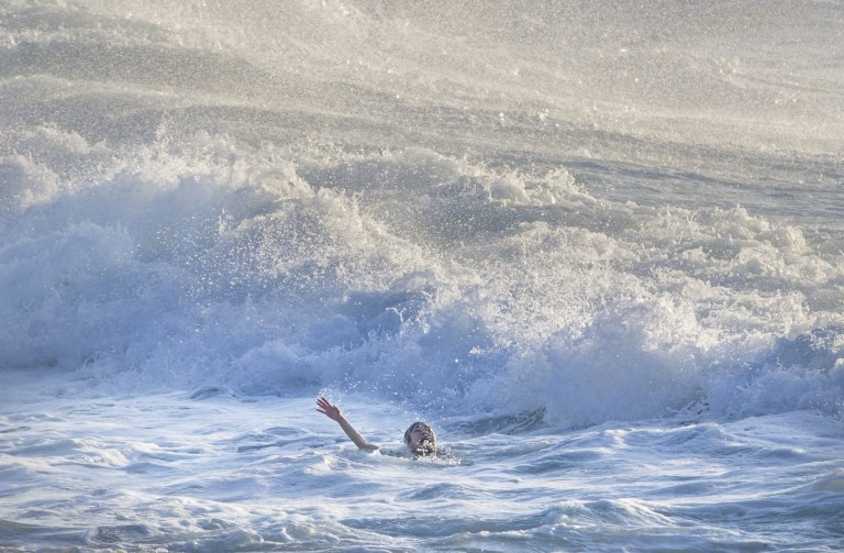 SYDNEY, AUSTRALIA - AUGUST 30: A woman screams for help as she is caught in a rip at Bronte Beach on August 30, 2018 in Sydney, Australia. The Bureau of Meteorology has issued a surf warning as massive waves continue to hit the NSW coast. The hazardous conditions are expected to render many coastal activities such as rock fishing, boating, and swimming too dangerous. (Photo by Jenny Evans/Getty Images)