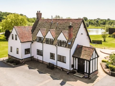 Gorgeous £2.85 million farmhouse has a pool, stables, a boating lake and a gym