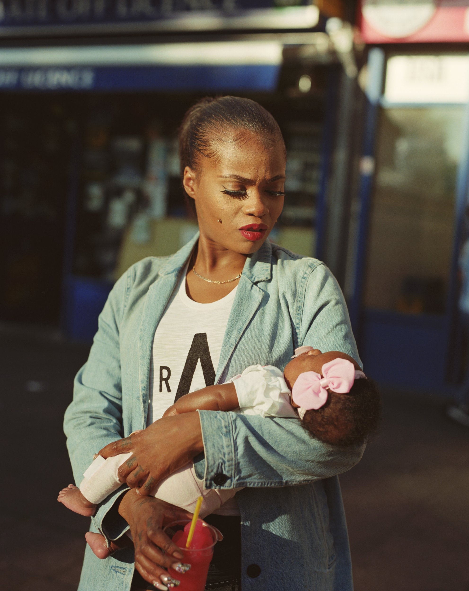 Undated handout photo issued by the National Portrait Gallery of Cybil McAddy with daughter Lulu from the series Clapton Blossom by Enda Bowe, which has been shortlisted for the annual Taylor Wessing Photographic Portrait Prize. PRESS ASSOCIATION Photo. Issue date: Thursday August 30, 2018. The portraits were selected from 4,462 submissions from 70 countries and more than 50 portraits will go on display. The winner will be announced on October 16. See PA story ARTS Portrait. Photo credit should read: Enda Bowe/PA Wire NOTE TO EDITORS: This handout photo may only be used in for editorial reporting purposes for the contemporaneous illustration of events, things or the people in the image or facts mentioned in the caption. Reuse of the picture may require further permission from the copyright holder.