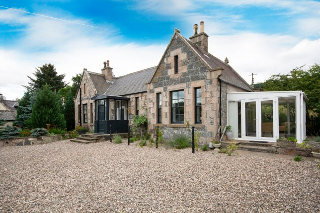 The former train station house which is up for sale in Gartly, Aberdeenshire. See SWNS copy CPSTATION: This is the unique two-bedroom house that will see its new owners living in a former station on a working railway. Bidders are in with the chance of living in the 164-year-old disused railway building - one of few lived-in station buildings in Scotland. Owners Helena and Euan Couperwhite, both 49, are reluctantly selling the single-story building in Gartly, Aberdeenshire on the Aberdeen-Inverness line after nearly five years.