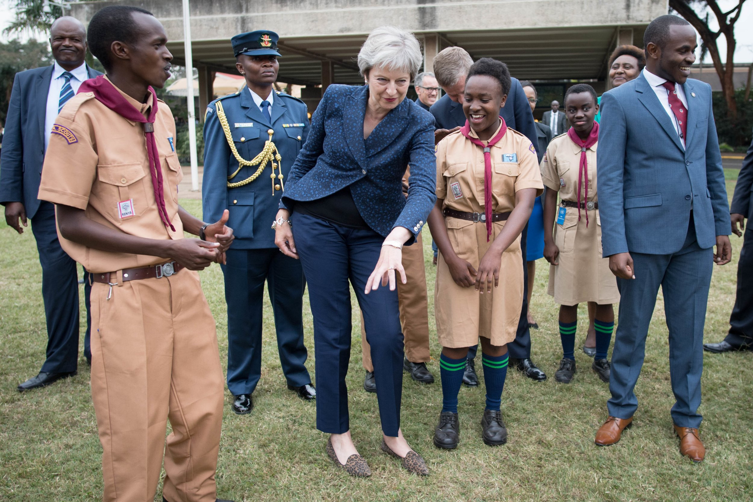 Prime Minister Theresa May in breaks into dance whilst meeting with scouts at the United Nations offices in Nairobi on the third day of her visit to Africa. PRESS ASSOCIATION Photo. Picture date: Thursday August 30, 2018. See PA story POLITICS Africa. Photo credit should read: Stefan Rousseau/PA Wire